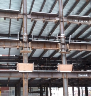Steel beams supporting composite steel and concrete deck flooring, USA (S. Brzev)