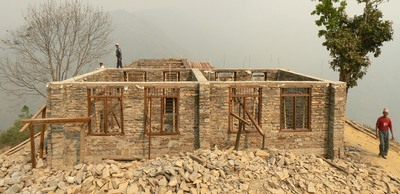 Stone masonry bulding with a reinforced concrete band at lintel level, Nepal (M. Schildkamp)