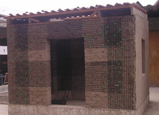 Adobe building reinforced with fibre reinforced mesh (geogrid), Peru (S. Brzev)