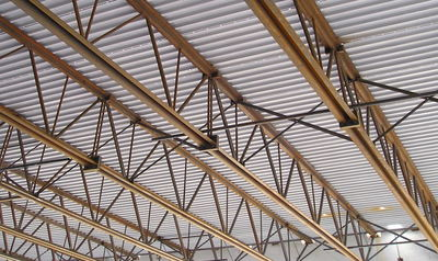 Steel trusses (open web steel joists) supporting corrugated steel roofing 2, Canada (S. Brzev)